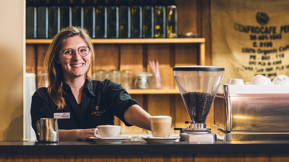 A barista makes coffee at the Furneaux Lodge Restaurant in the Marlborough Sounds at the top of New Zealand's South Island.
