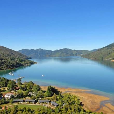Aerial view of Furneaux Lodge out over Endeavour Inlet in the Marlborough Sounds at the top of New Zealand's South Island.